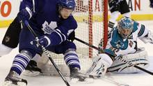San Jose Sharks goalie Evgeni Nabokov, right, makes a save on Toronto Maple Leafs' Nikolai Kulemin during second-period NHL hockey action in Toronto, February 8, 2010. (Darren Calabrese)