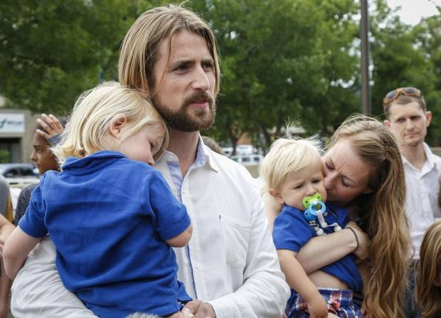 David Stephan, left, and Collet Stephan speak to supporters after arriving at the courthouse with their children in Lethbridge, Alta., on Friday, June 24.