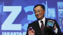 BlackBerry chief executive officer John Chen holds a Blackberry Z3 during a launch event in Jakarta, May 13, 2014. BlackBerry launched a low-cost touchscreen device in Jakarta, the Z3, as the embattled smartphone maker looks to revive sales in emerging markets like Indonesia where its once-fervent following has shrivelled. (BEAWIHARTA/REUTERS)