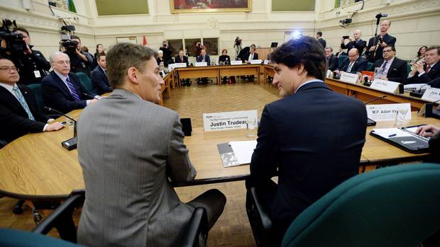 Prime Minister Justin Trudeau talks with Vancouver Mayor Gregor Robertson as he meets with the big city mayors in Ottawa on Friday, Feb. 5, 2016.