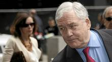 Conrad Black and his wife Barbara Amiel leave federal court in Chicago, June 24, 2011. (John Gress/REUTERS)