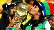 A replica of the World Cup is held by fans during the Opening Ceremony ahead of the 2010 FIFA World Cup South Africa Group A match between South Africa and Mexico at Soccer City Stadium (Clive Rose/2010 Getty Images)
