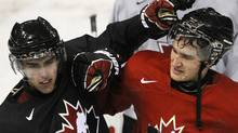 Team Canada's Brandon Gormley (L) and Mark Stone playfully rough each other up during practice in Edmonton December 25, 2011. REUTERS/Dan Riedlhuber (Dan Riedlhuber/Reuters)