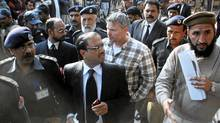 U.S. consulate employee Raymond Davis is escorted out of courtin Lahore on Jan. 28, 2011. Mr. Davis, jailed for shooting two Pakistanis, is shielded by diplomatic immunity. (REUTERS/Tariq Saeed)