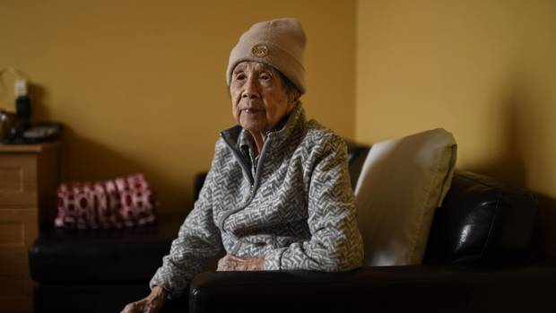 Foon Hay Lum poses for a photo in her room at her retirement home in Toronto on January 13, 2017.