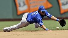 Toronto Blue Jays shortstop Maicer Izturis makes a diving stop on a ground ball from San Francisco Giants' Buster Posey during the fourth inning of a baseball game on Wednesday, June 5, 2013 in San Francisco. (Marcio Jose Sanchez/AP)