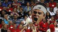 Canada fans react during the Davis Cup semi-final tennis match in Belgrade, Serbia (Darko Vojinovic/AP)