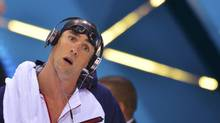 Michael Phelps of the U.S. arrives for the men's 200m butterfly semi-finals at the London 2012 Olympic Games at the Aquatics Centre July 30, 2012. Phelps placed first in his semi-final event. (TOBY MELVILLE/REUTERS)