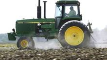 Deere & Co. reported lower-than-expected quarterly profits on Wednesday. (Seth Perlman/AP)
