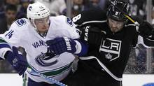 Los Angeles Kings' defenseman Drew Doughty (8) collides with Vancouver Canucks' right wing Alex Burrows (14) during Game 3 of their NHL Western Conference Hockey playoff quarter-finals in Los Angeles, California April 15, 2012. REUTERS/Danny Moloshok (Danny Moloshok/Reuters)