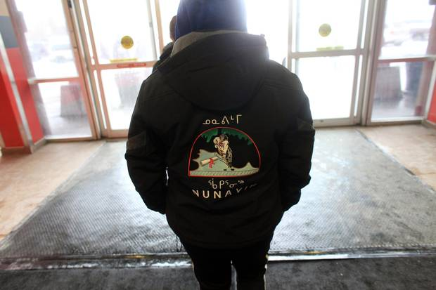 A member of the Nunavik Nordiks walks outside March 24, 2017 in Ottawa. The Inuit girl's hockey team is in Ottawa for a tournament.
