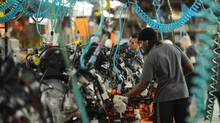 Statistics Canada says the largest impact to its revisions on productivity was in the years 1981 to 1990, when productivity growth was revised down by 0.3 per cent per year – to 1 per cent from 1.3 per cent. (Kevin Van Paassen/The Globe and Mail)