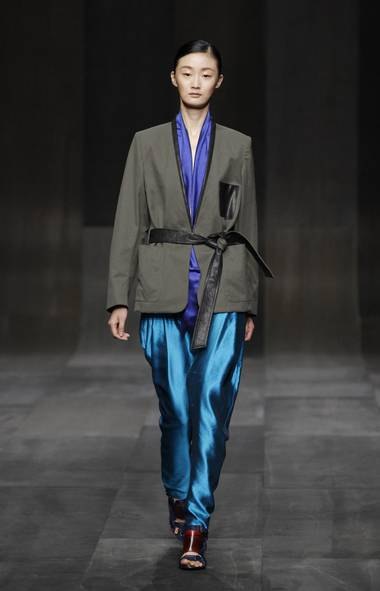 "Damir Doma, among the fresh young talents on the French fashion scene, was first up on the Paris Fashion Week schedule Wednesday morning. He cited a push and pull between ""aquatic and urban influences"" as the collection's theme. Here, silk shantung in turquoise and sapphire ripples around a deconstructed smoking jacket. (Reuters)"