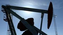 An oil pumpjack is silhouetted against the sun in Longview, Alta. Surge Energy is close to sealing its $244-million takeover bid for Longview Oil Corp. (Larry MacDougal/The Globe and Mail)