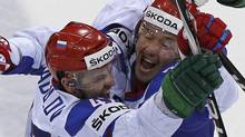 Russia's Alexander Radulov (L) and Russia's Ilya Kovalchuk celebrate a second goal against Canada during their quarter-final match at the Ice Hockey World Championships in Bratislava May 12, 2011. Radulov walked away from an NHL contract with Nashville in order to play in the KHL. REUTERS/Grigory Dukor (Grigory Dukor/Reuters)