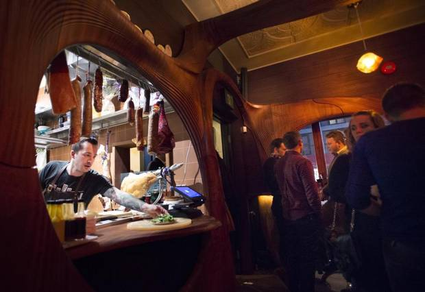 Head chef Grant van Gameren, left, works the pass as patrons take in the atmosphere at Bar Raval in Toronto on Wednesday, April 1, 2015.