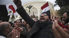 Muslim Brotherhood supporters chant slogans after a clash with anti-Morsi protesters next to the presidential palace in Cairo on Dec. 5. (Tara Todras-Whitehill/The New York Times)