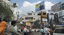 A bustling street in central Hyderabad, a city which has grown into a global technology hub. (Iain Marlow/The Globe and Mail)