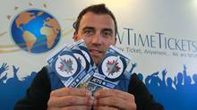 Mario Livich, a ticket broker with Show Time Tickets, holds up a batch of tickets to a Winnipeg Jets game in his offices in Vancouver October 11, 2011. The Jets franchise is putting new restrictions on ticket scalping. (Jeff Vinnick/Jeff Vinnick/The Globe and Mail)