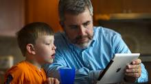 Stephen Hurley and his son Luke, 5, learn about butterflies on an iPad in Milton, Wednesday September 5/2012. (Kevin Van Paassen/The Globe and Mail)