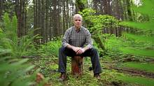Cariboo North MLA Bob Simpson sits on a log in Stanley Park in Vancouver June 6, 2012. (Jeff Vinnick)