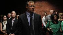 """Blade Runner"" Oscar Pistorius awaits the start of court proceedings in the Pretoria Magistrates court February 19, 2013. (SIPHIWE SIBEKO/REUTERS)"