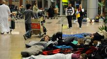 Tourists and Egyptians stranded at Cairo s international airport sleep late on January 29, 2011 as they can t leave the airport due to the curfew being brought forward in the Egyptian capital following anti-government riots. (Miguel Medina/AFP/Getty Images/Miguel Medina/AFP/Getty Images)