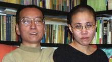 (FILES) This file photo taken on October 22, 2002 shows Chinese dissident and Nobel Peace laureate Liu Xiaobo (L) and his wife Liu Xia (R) posing for a picture in Beijing. (AFP/AFP/Getty Images)