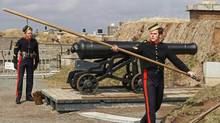 Members of the 78th Highlanders prepare to fire the noon gun on Citadel Hill in Halifax on Monday April 10, 2006. A decades-long dispute between Halifax and the federal government over the value of Citadel Hill will go before a panel Monday to help determine how much Ottawa owes the city in back taxes for the national historic site. (Andrew Vaughan/THE CANADIAN PRESS)