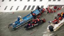In this image taken from video from Mokpo Coast Guard, passengers from a ferry sinking off South Korea's southern coast, are rescued by South Korean Coast guard in the water off the southern coast near Jindo, south of Seoul, Wednesday, April 16, 2014. (AP)