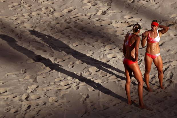 Heather Bansley of Canada, right, and teammate Sarah Pavan look on during a women's quarterfinal match between Canada and Germany on Day 9 of the Rio 2016 Olympic Games at the Beach Volleyball Arena on August 14, 2016 in Rio de Janeiro, Brazil.