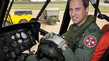 Britain's Prince William sits in the cockpit of a helicopter at RAF Valley in Anglesey Wales on June 1, 2012. (SAC Faye Storer/THE CANADIAN PRESS)