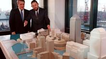 Paul Reichmann and Brian Mulroney look at a model of the proposed Canary Wharf in London. Reichmann has died at the age of 83. (Ron Poling/CANADIAN PRESS)