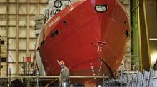 A worker stands near CCGS Constable Carrière, a Hero-class patrol vessel, at the Irving shipyard in Halifax on Oct. 19, 2012. Ottawa announced in 2011 that the Irving shipyard would receive the lion's share of its $35-billion federal shipbuilding procurement project. (Andrew Vaughan/THE CANADIAN PRESS)