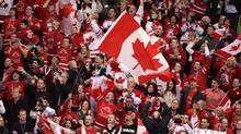 Fans react to Team Canada's first goal during the gold medal hockey game in Vancouver February 28, 2010 at the 2010 Olympics. (JOHN LEHMANN/The Globe and Mail)
