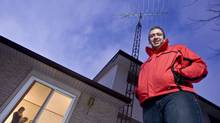 Eryn Smit of Chatham, Ont. cancelled his cable subscription two years ago after he discovered he can receive all the channels he needs including many in HD over his 10 foot antenna. (GEOFF ROBINS for The Globe and Mail)