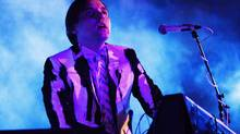 "William Butler, a member of Arcade Fire, billed as the band ""The Reflektors,"" plays Thursday, Oct. 24, 2013 at the Little Haiti Cultural Center in Miami. (Eric Kayne/AP)"