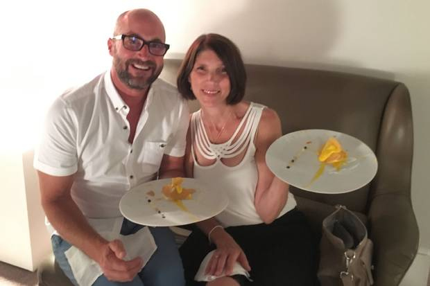 """Matt and Laura Clancy hold the """"Oops, I dropped the lemon tart"""" dish at her birthday dinner at triple-Michelin-starred restaurant Osteria Francescana in Modena, Italy."""