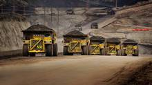 Caterpillar trucks working in the oil sands in Alberta. (Caterpillar Inc.)