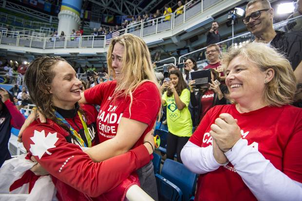 Penny Oleksiak with family members after she won gold in Women's 100m Freestyle Final at Olympic Aquatics Stadium during Rio Olympics August 11, 2016.