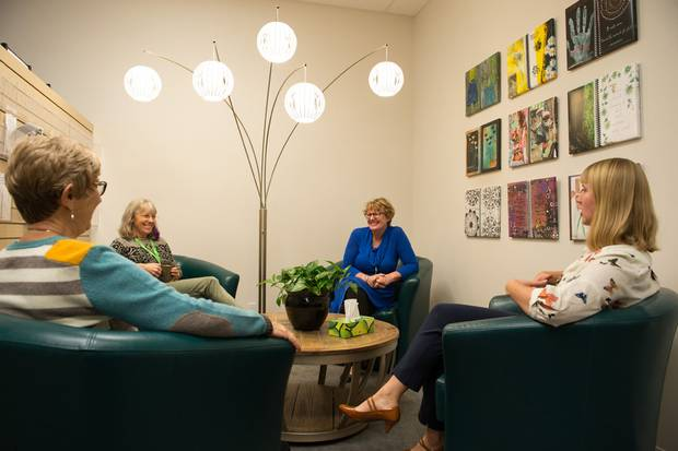 Members sit in the conversation area at Wellspring Calgary's Fountain Court location. The organization provides free non-medical support to people living with any stage of cancer, from diagnosis to post-treatment.
