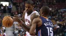 Toronto Raptors' Amir Johnson drives at Charlotte Bobcats' Kemba Walker during first half NBA basketball action in Toronto on Friday January 11 , 2013. (The Canadian Press)