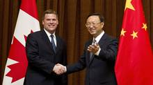 Canadian Foreign Minister John Baird, left, is greeted by his Chinese counterpart Yang Jiechi during his visit to China's Foreign Ministry office in Beijing, China, Monday, July 18, 2011. (Andy Wong/AP)