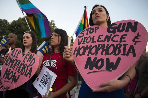 June 12, 2016: Mourners in Washington, D.C., hold a vigil for the deadly shooting at a gay nightclub in Orlando, Fla., the night before.