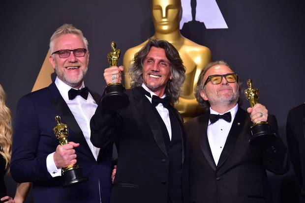 Alessandro Bertolazzi (R), Giorgio Gregorini (C) and Christopher Nelson (L) poses with the Oscar for Best Makeup and Hairstyling in the press room, during the 89th Oscars on February 26, 2017, in Hollywood.