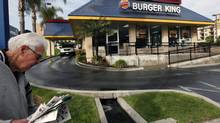 Companies with less market share – such as Burger King – usually have higher customer satisfaction scores than the dominant brand. (NICK UT/THE CANADIAN PRESS)