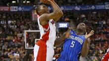 Toronto Raptors guard Kyle Lowry drives through Orlando Magic guard Victor Oladipo to make a shot at the Air Canada Centre. Toronto defeated Orlando 105-90. (John E. Sokolowski/USA Today Sports)