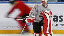 Canada's goalie Jordan Binnington stretches a player skates by during team practice at the 2013 IIHF U20 World Junior Hockey Championship in Ufa, January 4, 2013. (MARK BLINCH/REUTERS)