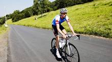 Cyclist Ryder Hesjedal of Canada rides during a training session for the Cycling Road Race ahead of the 2012 London Olympic games on the Box Hill circuit, southwest of London, on July 26. (MARK BLINCH/REUTERS)