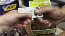Canadians still turning to credit and going into debt to finance their lifestyles. (Ryan Remiorz/THE CANADIAN PRESS)